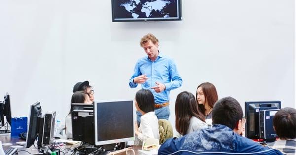 business teacher studying entrepreneurship