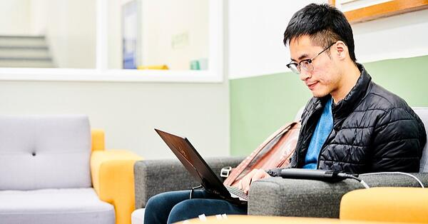 international student working on laptop